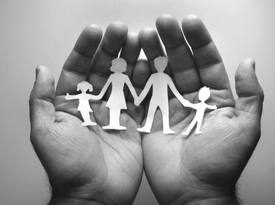cut_out_family_in_hands