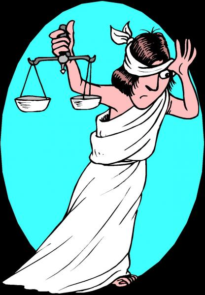 Lady Justice peeking from blindfold